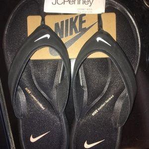 Nike Shoes - Foam bed Nike flip flops (size 6 US women's) NWT